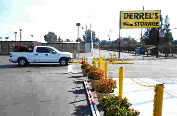 Parking lot and sign of Derrels at 1800 W Belmont Ave, Fresno, CA