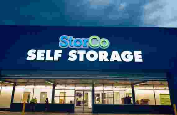 Front entrance sign at StorCo Storage at 1401 Vaughn Rd, Wood River, IL