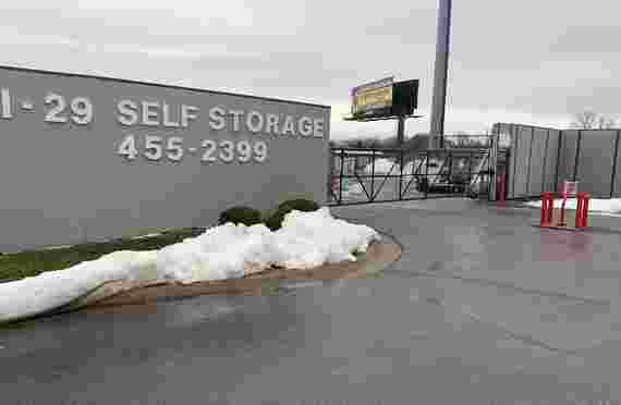 Front sign and gate to I-29/I-35 Self Storage