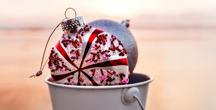ornaments in a bucket on the beach used for winter storage tips in Arroyo Grande, CA