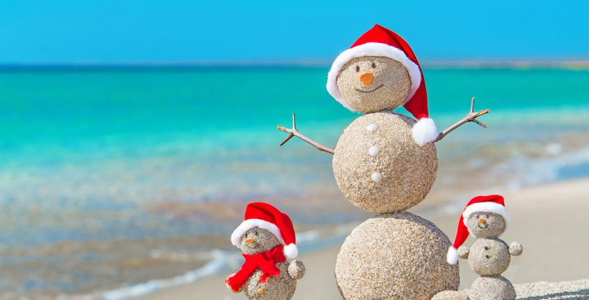snowman family made of sand on beach with Santa hats used for California storage tips | Rock Safe