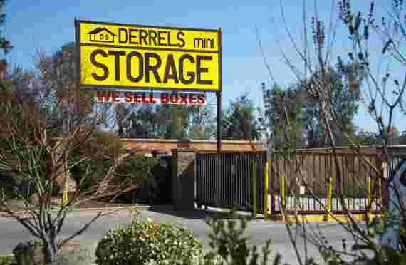 Front office signage and gate at Derrels at 4660 E Dakota Ave, Fresno, CA