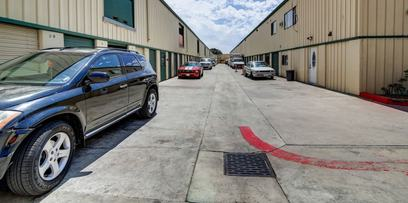 Cars line one of the extra-wide lanes between the buildings at StaxUP Storage in Chula Vista, CA.