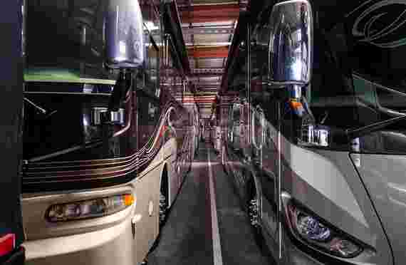 RVs neatly stored inside at RV Storage Depot at 13555 Excelsior Dr, Norwalk, CA