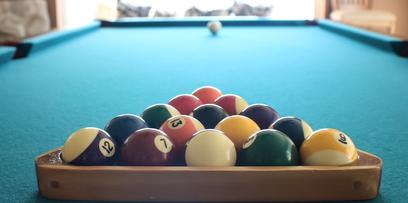 A pool table in a home set up for a game