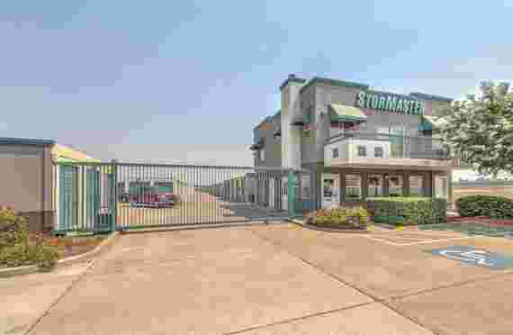 Image Of Outside Entrance Gated Facility StorMaster Self Storage in Pittsburg, CA